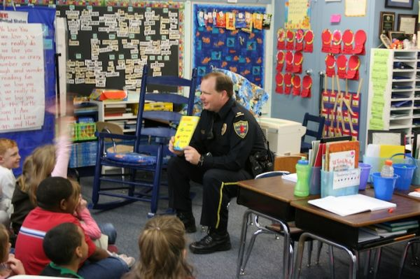 Lt. Wayne Barlow reading.